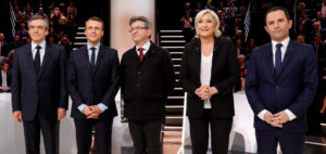 (LtoR) French presidential election candidates, right-wing Les Republicains (LR) party Francois Fillon, En Marche ! movement Emmanuel Macron, far-left coalition La France insoumise Jean-Luc Melenchon, far-right Front National (FN) party Marine Le Pen, and left-wing French Socialist (PS) party Benoit Hamon, pose before a debate organised by the French private TV channel TF1 on March 20, 2017 in Aubervilliers, outside Paris. / Photo credit to PATRICK KOVARIK/AFP/Getty Images