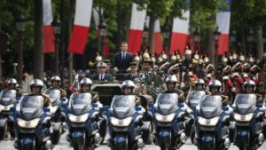 The new French president was driven in an open-top military vehicle up the Champs-Élysées. Photo credit to BBC